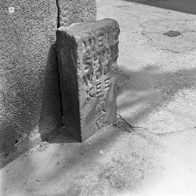 "boundary stone: ""WEI SHIH. WOO KEE 費界"""